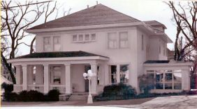 "Ward - Willinham Home: While it has been reported that ""early day saloon man"" Tom Ward, built this house in 1904. It was in fact built by Tom's brother (name unknown) whom was president of one of the local banks at the time. The veranda columns are of ""low relief"" ornamentation, resembling terra cotta. The naturalistic stylized foliage interlaced with repeating motifs is reminiscent of the ""Sullivanesque"" style . Today, Jerry and Glenda Willingham reside within these historic walls at 309 8th. Street."