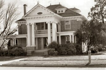 "Giescke - Sykes Home: This classic ""revival style"" structure is located at 609 8th Street. Built in 1910 by rancher/banker Herman Giescke, this home has been well cared for b each of its owners. The home is currently owned by Mr. and Mrs. Bill Sykes."